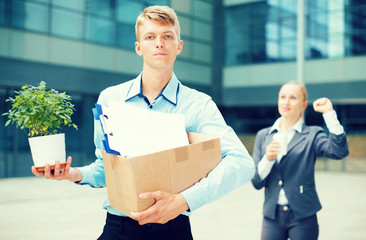 Businesswoman is wishing good luck to worker