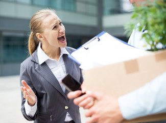 Angry businesswoman is chastising  the employee