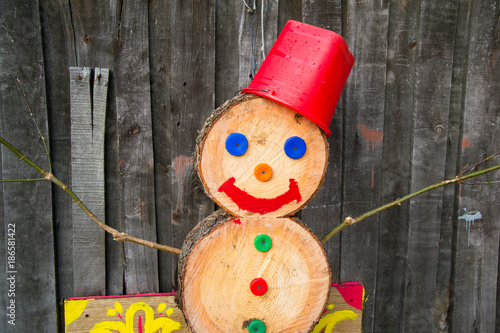 a snowman made of wood blocks to celebrate christmas during a snowless winter