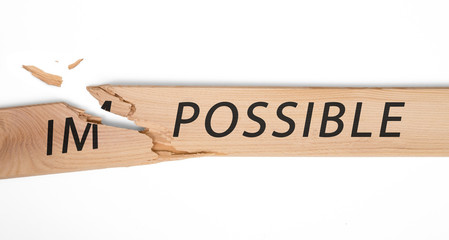 "breaking off a piece of the plate with the word ""impossible"" and gets the word ""possible"""