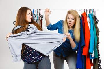Women arguing during clothes shopping