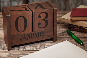 Perpetual Calendar in desk scene with blank diary page, January 3rd