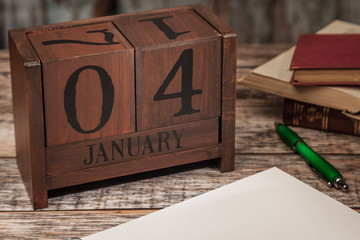 Perpetual Calendar in desk scene with blank diary page, January 4th