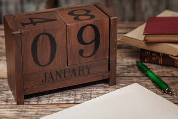 Perpetual Calendar in desk scene with blank diary page, January 9th