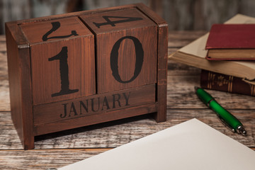 Perpetual Calendar in desk scene with blank diary page, January 10th