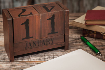 Perpetual Calendar in desk scene with blank diary page, January 11th