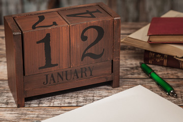 Perpetual Calendar in desk scene with blank diary page, January 12th