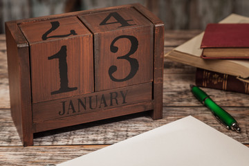 Perpetual Calendar in desk scene with blank diary page, January 13th