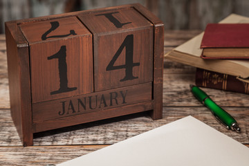 Perpetual Calendar in desk scene with blank diary page, January 14th