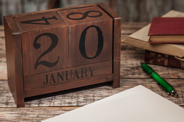 Perpetual Calendar in desk scene with blank diary page, January 20th