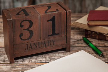 Perpetual Calendar in desk scene with blank diary page, January 31st