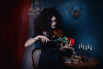 Evil witch plays the violin without strings