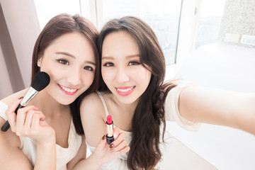two beauty woman in home