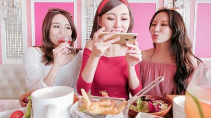 women take picture in restaurant