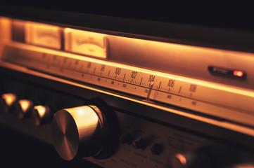 Vintage FM radio amplifier with retro tuner scale