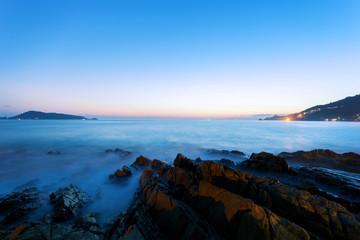 Fotobehang Blauwe hemel Dramatic sky seascape with rock in sunset scenery background.
