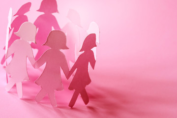 The Sweet pink  girl paper doll on pink background  for Women ' s day symbol to promote  in 8 march month campaign