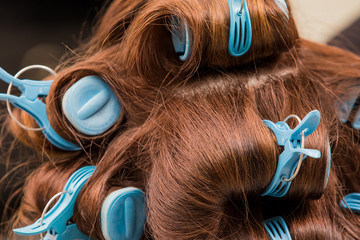 Close up of hair curlers in hair