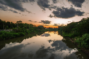 landscape of the river under the twilight sky