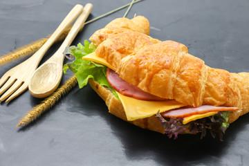 Croissant Ham cheese on black floor