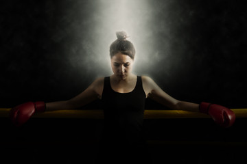 Portrait of woman training gym boxing ring