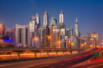 Fotobehang Las Vegas Dubai Marina Skyline at night in United Arab Emirates with light trails and skyscrapers at the background