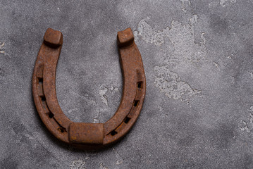 Rustic iron horseshoe on grey background