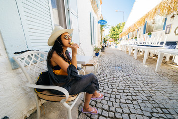 Woman sitting on the street of europe and eating ice cream