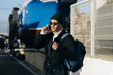 Stylish tourist talking on phone
