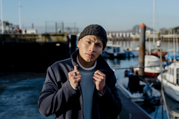 Handsome man posing in port