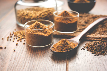 Indian spice coriander powder and cumin or jeera powder powder heap, selective focus