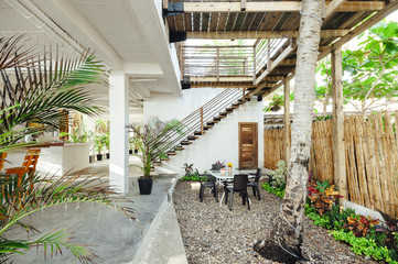 Beach house terrace with a stones floor under a wooden structure in Palomino, Magdalena, Colombia
