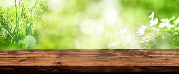Bright green spring background with table