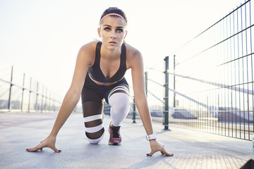Fit woman ready to sprint