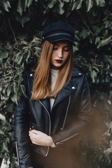 Trendy girl in black on green background