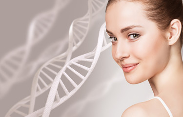 Portrait of sensual woman among DNA chains