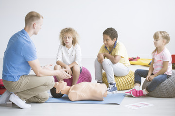 Paramedic and children during training