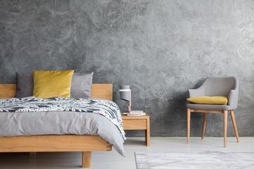 Dark bedroom with grey chair