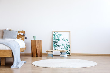 Floral poster in bright bedroom