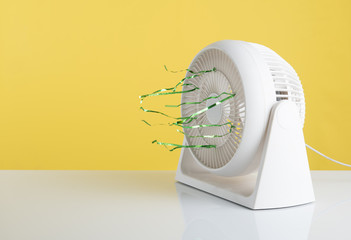 Plastic white electric fan in working mode with Text Space on yellow background