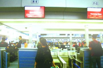 Blur image of passengers queue at the check-in counters in airport, holidays traveling crowded aviation transportation