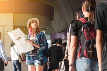 Woman westerner looking at map during city tour in the morning, Westerner tourist conceptual