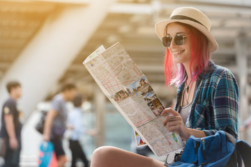 Woman westerner looking at map during city tour in the morning, planning for today's trip