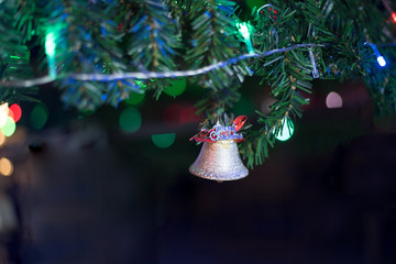 Christmas decoration adorn on Christmas tree with fir, bell, ribbon and bokeh background, beautiful at night for celebration