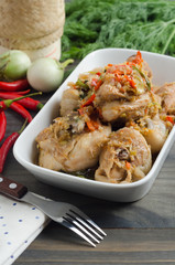 Spicy steamed chicken with herbs. Thai food concept.