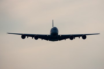 Airbus A380 Jumbo Jet airplane flying in frount of cloudy sky