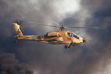 AH-64 Apache attack helicopter fly above Hatzerim Air Force base near Beersheba, Israel in front of black smoke