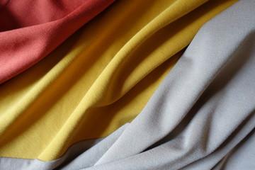 Rippled orange, yellow and beige jersey fabric Fototapete