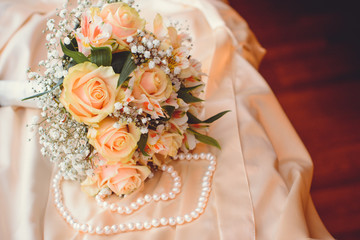 Romantic morning of the bride in detail. Wedding bouquet of white roses