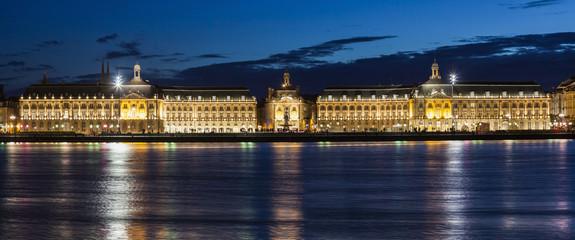 France, Nouvelle-Aquitaine, Bordeaux, Place de la Bourse across Garonne River at night
